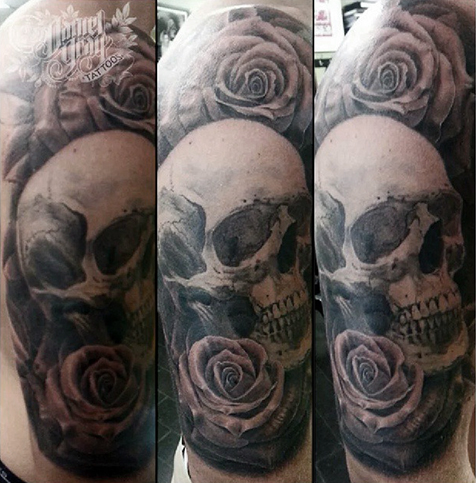 Skull and roses half sleeve tattoo by Daniel Gray
