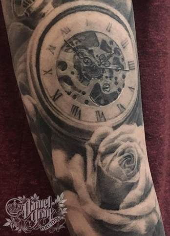 Pocket watch and roses on forearm, tattoo by cincinnati artist Daniel Gray