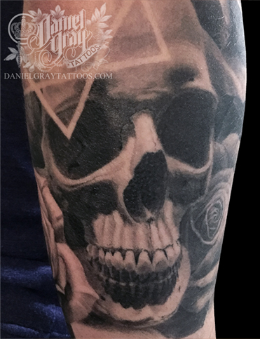 Skull and rose on forearm, tattoo by Daniel Gray