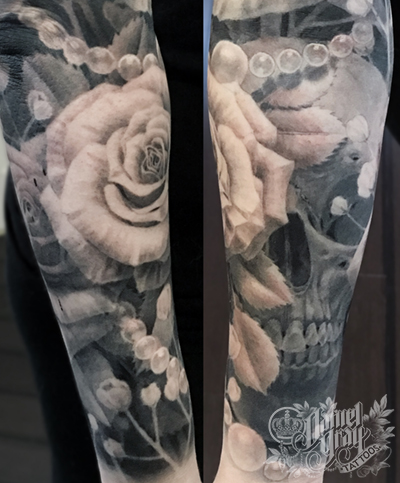 Skull, roses and pearls on forearm, tattoo by cincinnati artist Daniel Gray